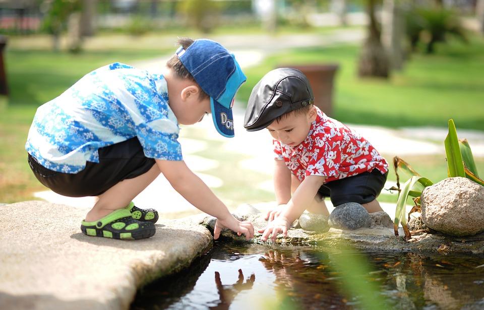 boys near pond