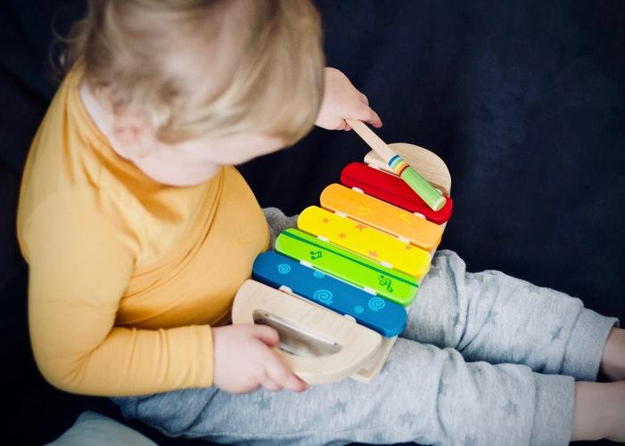 little boy playing music
